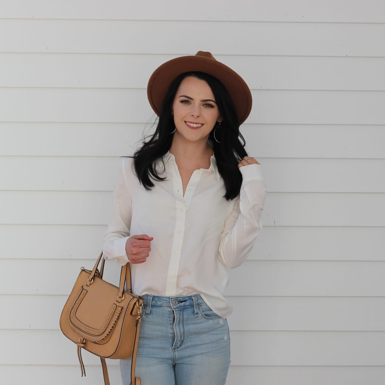 How to Style a White Button-Down Shirt With Jeans
